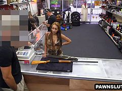 Brunette babe posing for some photos at the pawn shop